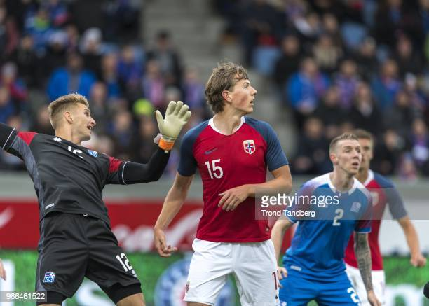 Sander Berge of Norway Frederik Schram of Iceland during International Friendly between Iceland v Norway at Laugardalsvollur National Stadium on June...