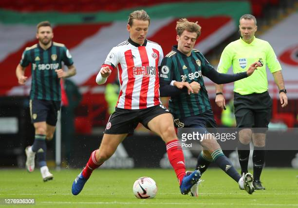 Sander Berge of Sheffield United battles for possession with Patrick Bamford of Leeds United during the Premier League match between Sheffield United...