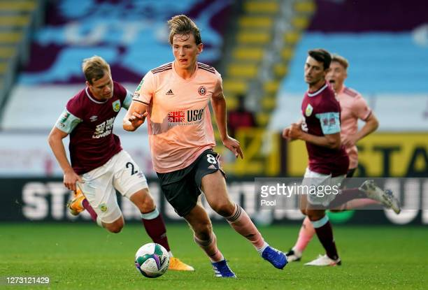Sander Berge of Sheffield United is put under pressure by Matej Vydra of Burnley during the Carabao Cup second round match between Burnley and...