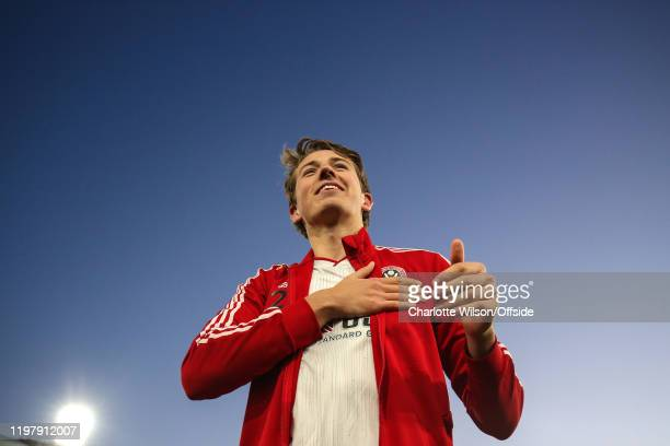 Sander Berge of Sheffield United pats the Sheff U badge after receiving a warm welcome from the fans during the Premier League match between Crystal...