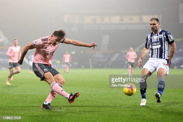 Sander Berge of Sheffield United shoots past Branislav Ivanovic of West Bromwich Albion during the Premier League match between West Bromwich Albion...