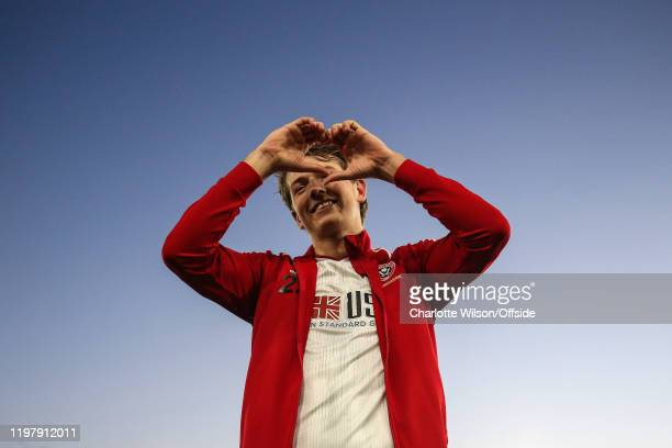 Sander Berge of Sheffield United signs a heart to the fans in response to their warm welcome during the Premier League match between Crystal Palace...