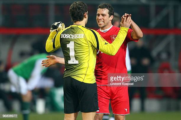 Sander Boschker of Enschede and Peter Wisgerhof celebrate the 10 victory after the UEFA Europa League knockout round first leg match between FC...