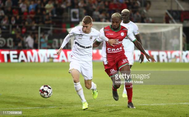 Sander Coopman of Antwerp battles for the ball with Cyle Larin of Zulte during the Jupiler Pro League match between SV Zulte Waregem and Royal...