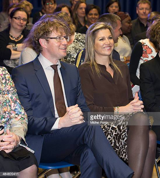Sander Dekker and Queen Maxima of The Netherlands attends an evening with parents discussing financial education at elementary school The Archipel on...