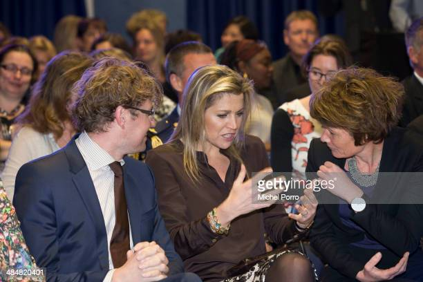 Sander Dekker, Queen Maxima of The Netherlands and Gita Salden attends an evening with parents discussing financial education at elementary school...