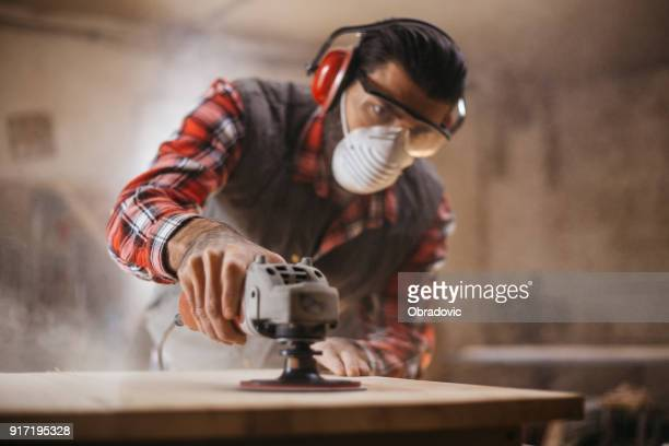 sander in action - carpenter stock pictures, royalty-free photos & images
