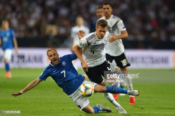 Sander Puri of Estonia is tackled by Matthias Ginter of Germany during the UEFA Euro 2020 Qualifier match between Germany and Estonia at Opel Arena...
