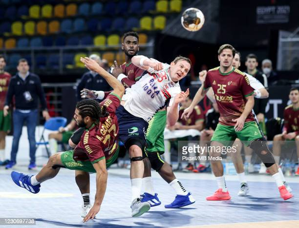 Sander Sagosen of Norway and Andre Gomes of Portugal during the 27th IHF Men's World Championship Group III match between Portugal and Norway at Dr....