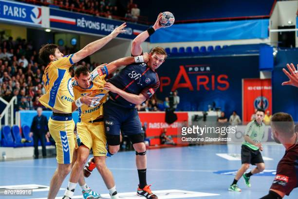 Sander Sagosen of Paris Saint Germain is trying to pass the ball against Krzysztof Lijewski and Marko Mamic of PGE Vive Kielce during the Champions...