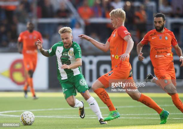 Sander Svendsen of Hammarby IF and Ludvig Ohman Silwerfeldt of Athletic FC Eskilstuna competes for the ball during the Allsvenskan match between...