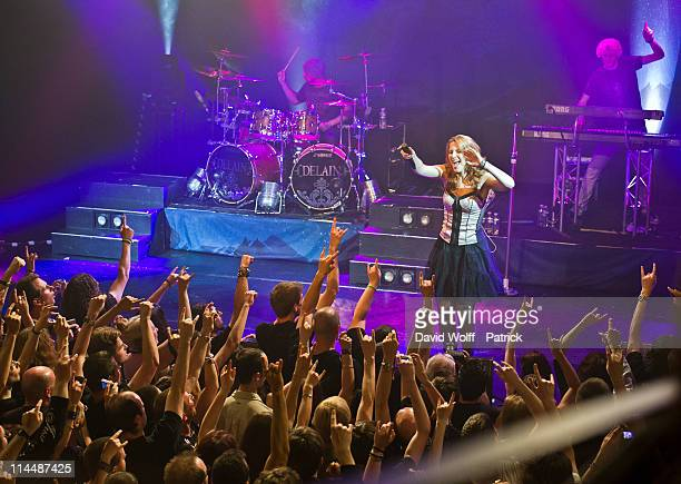 Sander Zoer Charlotte Wessels and Martijn Westerholt of Delain perform at L'Alhambra on May 21 2011 in Paris France