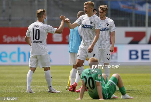 Sandhausen players Julius Biada and Aleksandr Zhirov celebrate victory during the Second Bundesliga match between SV Sandhausen and Hannover 96 at...