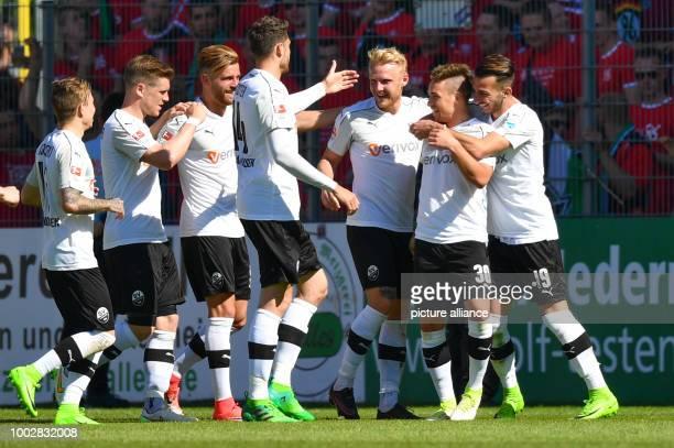 Sandhausen's Thomas Pledl celebrates with teammates his 10 opener during the German Bundesliga 2nd league soccer match between SV Sandhausen and...