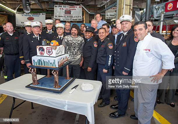 Sandhog Joe Barone poses with some of the FDNY firefighters and medics who rescued him from chesthigh mud after he fell while working in the tunnel...