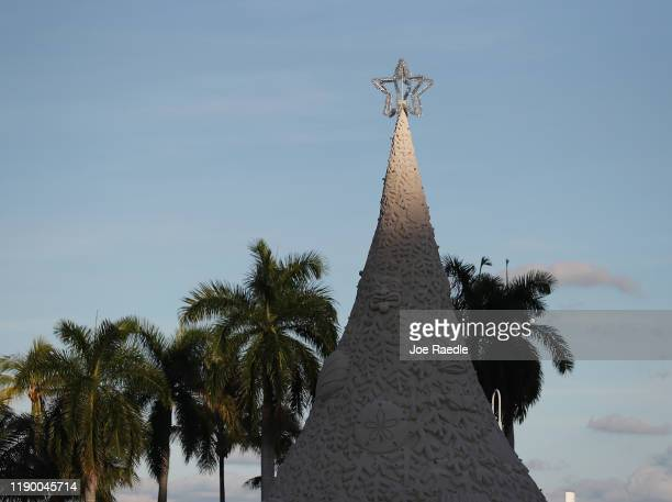 """""""Sandi"""" the world's only 700ton sand tree is seen as sculptors from Sandtastic near the completion of the holiday sand tree on November 25 2019 in..."""