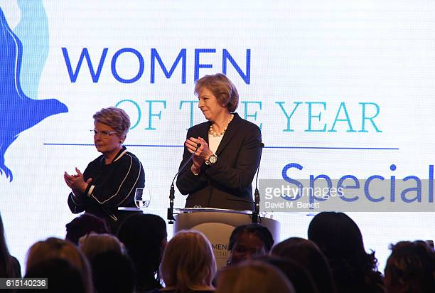 Sandi Toksvig and British Prime Minister Theresa May attend The 61st Women of the Year lunch and awards 2016 at InterContinental Park Lane Hotel on...