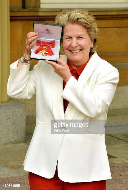 Sandi Toksvig holds her OBE after it was presented to her by Prince Charles Prince of Wales during an Investiture Ceremony at Buckingham Palace on...