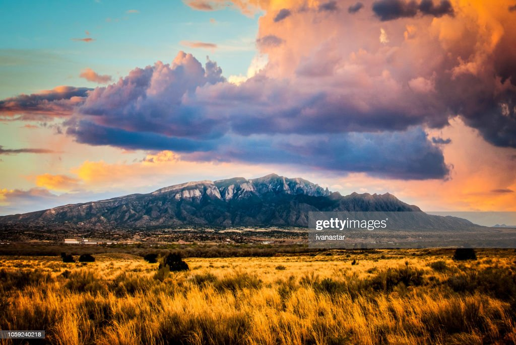 Sandia Mountains with Majestic Sky and Clouds : Stock Photo