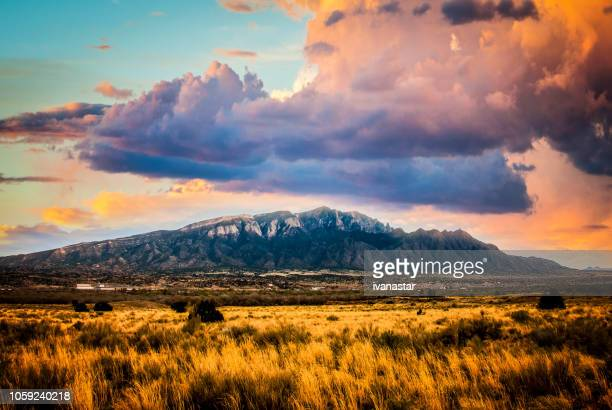 sandia mountains with majestic sky and clouds - nuovo messico foto e immagini stock