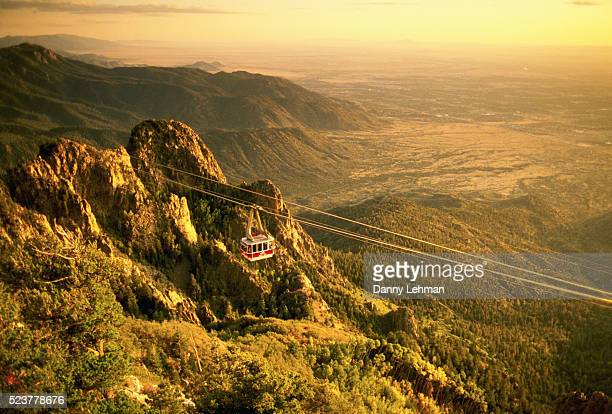 sandia tramway and mountains - sandia mountains stock photos and pictures