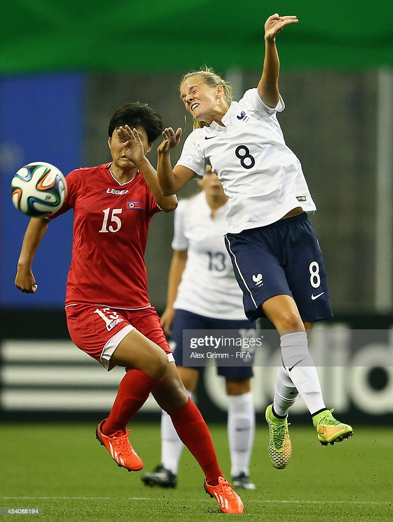 Sandie Toletti 8r9 of France is challenged by Jo Ryon Hwa of Korea DPR during the FIFA U-20 Women's World Cup Canada 2014 3rd place match between Korea DPR and France at Olympic Stadium on August 24, 2014 in Montreal, Canada.