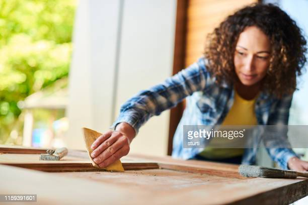 sanding an old door - restoring stock pictures, royalty-free photos & images