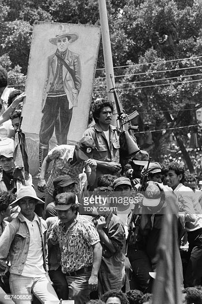 Sandinista guerillas arrive triomphant in the Nicaraguan capital of Managua following the resignation and expropriation of Dictator Anastasio Somoza