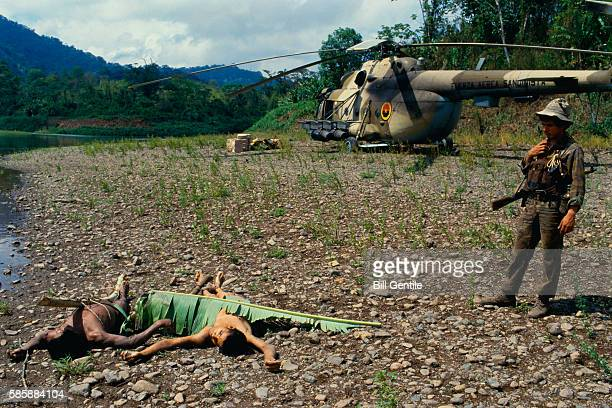 Sandinista Stands Over Two Dead Contras