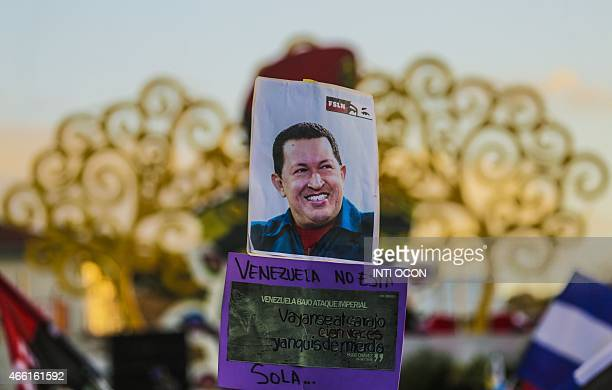 A Sandinista supporter holds a picture of late president Hugo Chavez during a Nicaraguan government sponsored rally in support of Venezuela in...