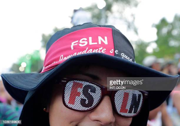 A Sandinista supporter takes part in a march for Nicaraguan President Daniel Ortega in Managua on September 19 2018 Thousands of supporters of...