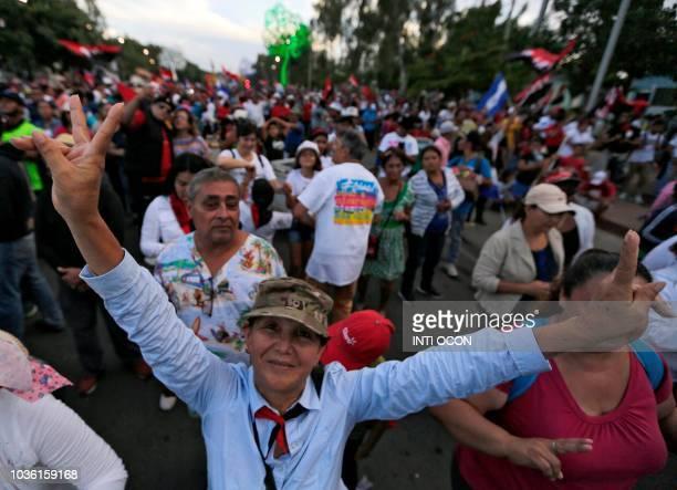 Sandinista supporters march for Nicaraguan President Daniel Ortega in Managua on September 19 2018 Thousands of supporters of Nicaraguan President...