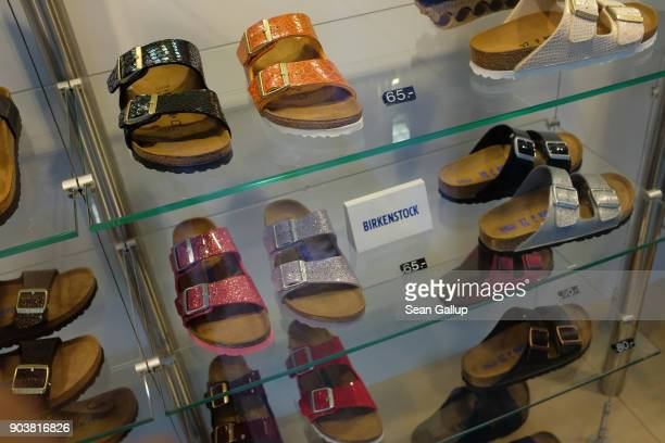 Sandles lie on display in the sindow of a Birkenstock store on January 11 2018 in Berlin Germany Much of the German consumer goods and foodstuffs...