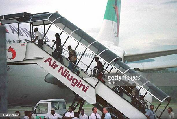 Sandline International mercenaries board an Air Niugini flight in Port Moresby Papua New Guinea 21 March after PNG Prime Minister Sir Julius Chan...