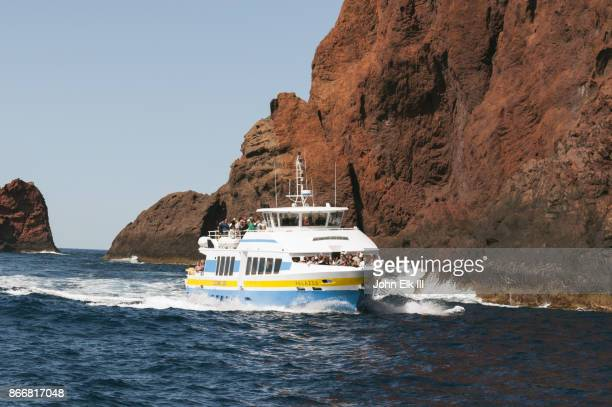 sandola nature reserve, tour boat along cliffs - nature reserve stock pictures, royalty-free photos & images