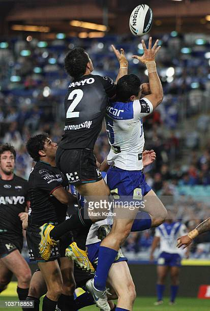 Sandor Earl of the Panther and Bryson Goodwin of the Bulldogs compete for the ball during the round 25 NRL match between the Canterbury Bulldogs and...