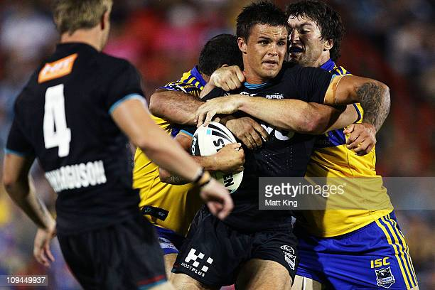 Sandor Earl of the Panthers is wrapped up by the defence during the NRL trial match between the Penrith Panthers and the Parramatta Eels at Centrebet...