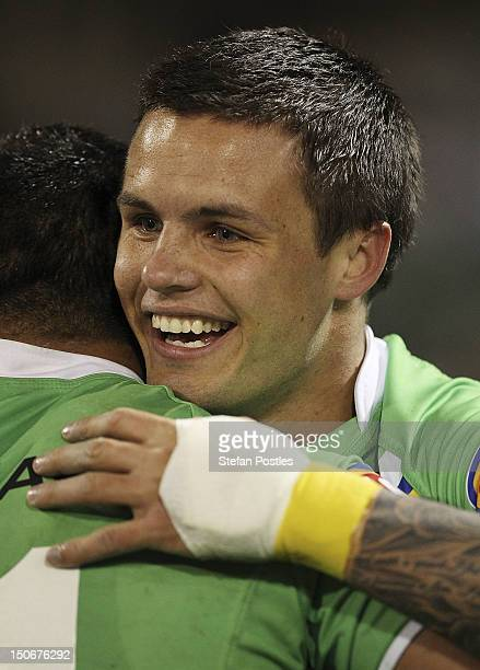 Sandor Earl of the Raiders is congratulated by a team mate after scoring a try during the round 25 NRL match between the Canberra Raiders and the...