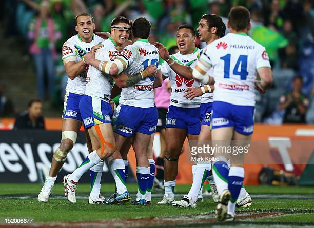 Sandor Earl of the Raiders is congratulated by his team mates after scoring a try during the NRL Semi Final match between the South Sydney Rabbitohs...
