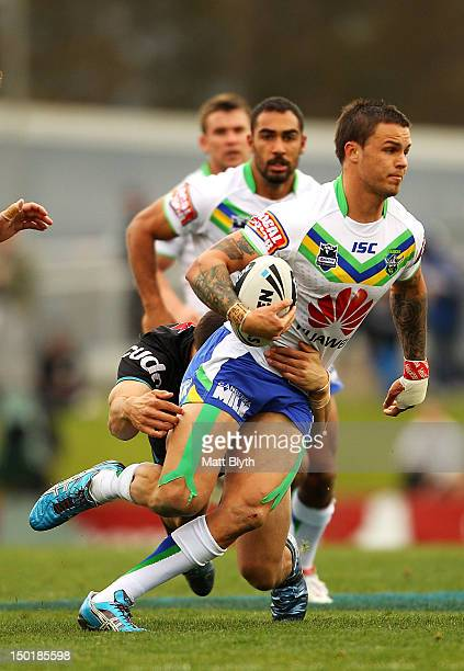 Sandor Earl of the Raiders is tackled during the round 23 NRL match between the Penrith Panters and the Canberra Raiders at Centrebet Stadium on...