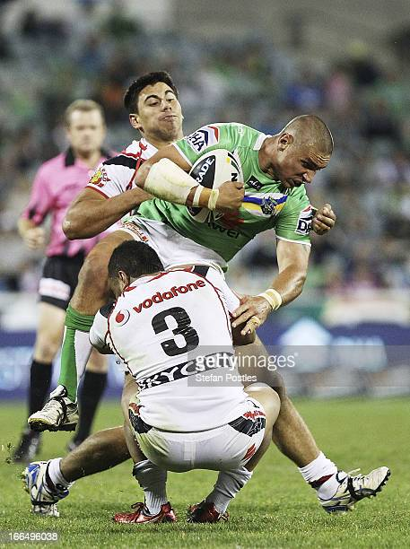 Sandor Earl of the Raiders is tackled during the round six NRL match between the Canberra Raiders and the New Zealand Warriors at Canberra Stadium on...