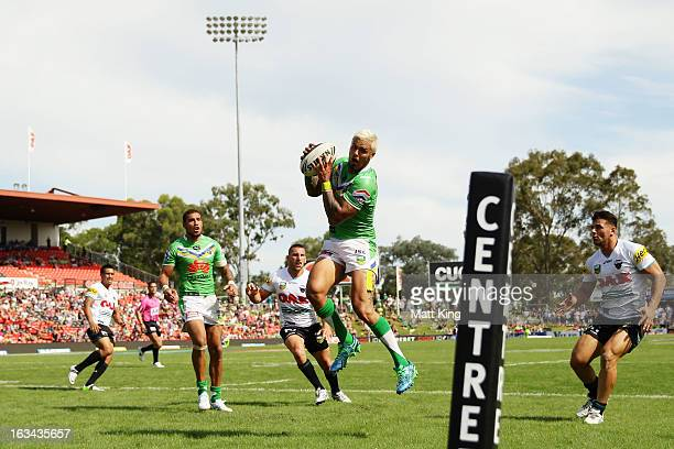 Sandor Earl of the Raiders jumps for a high ball during the round one NRL match between the Penrith Panthers and the Canberra Raiders at Centrebet...
