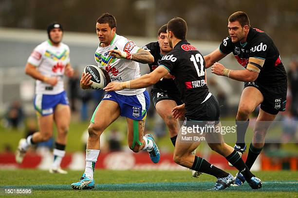 Sandor Earl of the Raiders makes a break during the round 23 NRL match between the Penrith Panters and the Canberra Raiders at Centrebet Stadium on...