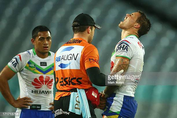Sandor Earl of the Raiders receives attention for a dislocated elbow during the round 16 NRL match between the South Sydney Rabbitohs and the...