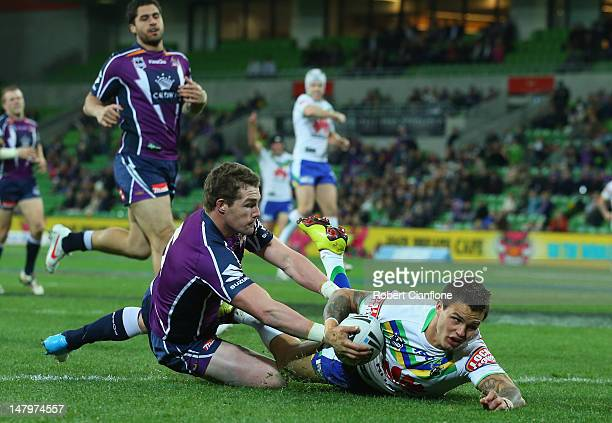 Sandor Earl of the Raiders scores a try during the round 18 NRL match between the Melbourne Storm and the Canberra Raiders at AAMI Park on July 7...