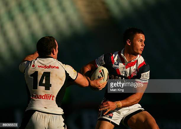 Sandor Earl of the Roosters takes on the Warriors defence during the round 19 NRL match between the Sydney Roosters and the Warriors at the Sydney...