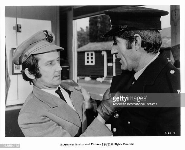 Sandor Elès as an officer, holds another officer, Fredric Abbott by the lapel of his coat in a scene from the film '1,000 Convicts And A Woman', 1971.