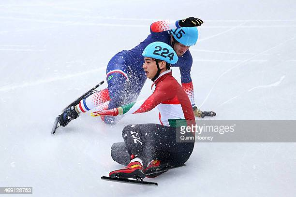 Sandor Liu Shaolin of Hungary and Thibaut Fauconnet of France collide compete in the Short Track Men's 1000 m Heat on day 6 of the Sochi 2014 Winter...