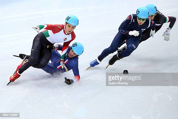 Sandor Liu Shaolin of Hungary and Thibaut Fauconnet of France collide as HanBin Lee of South Korea and Yuri Confortola of Italy skate past in the...