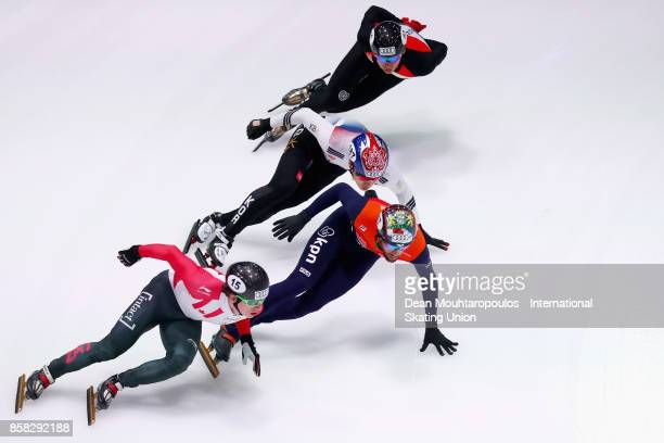 Sandor Liu Shaolin of Hungary Daan Breeuwsma of the Netherlands Charle Cournoyer of Canada and Do Kyoum Kim of South Korea lead in their Mens 1000m...